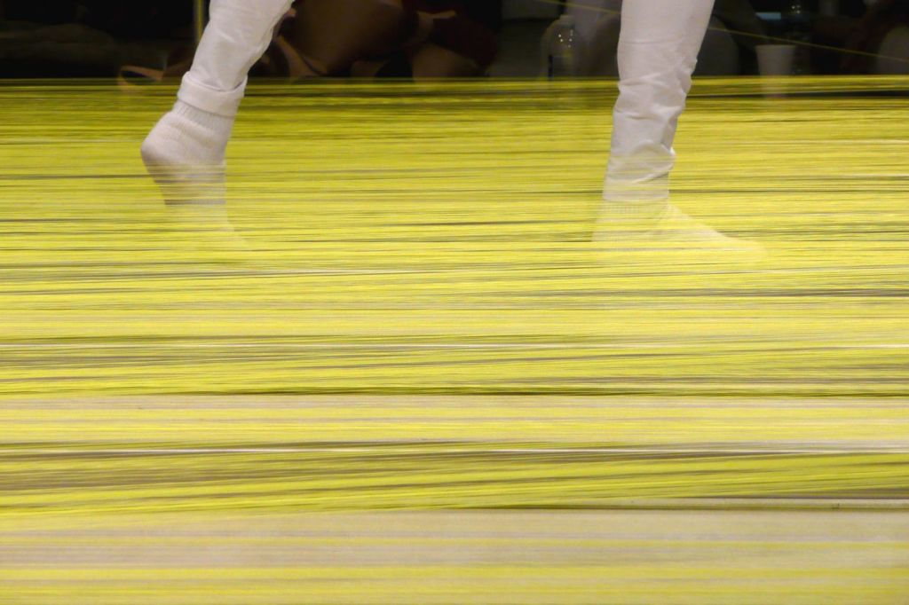 Anne Wilson, Wind Up: walking the warp, January 20-25, 2008, documentation of performance.  From Wind-Up: walking the warp, Research Document, 2008.